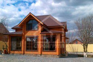 Двухэтажные деревянные дома из сруба