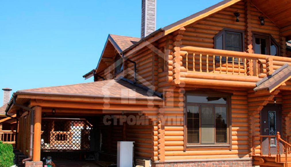Дом с гаражом из сруба